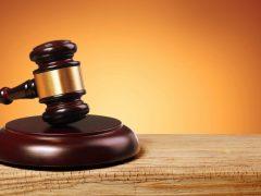 Judge gavel and soundboard over gold background